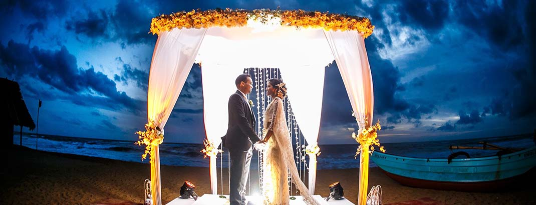Wedding Couple on an Outdoor Poruwa Set in Mount Lavinia Beach